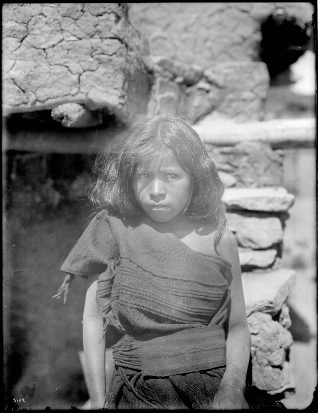 Hopi Indian girl sitting outside