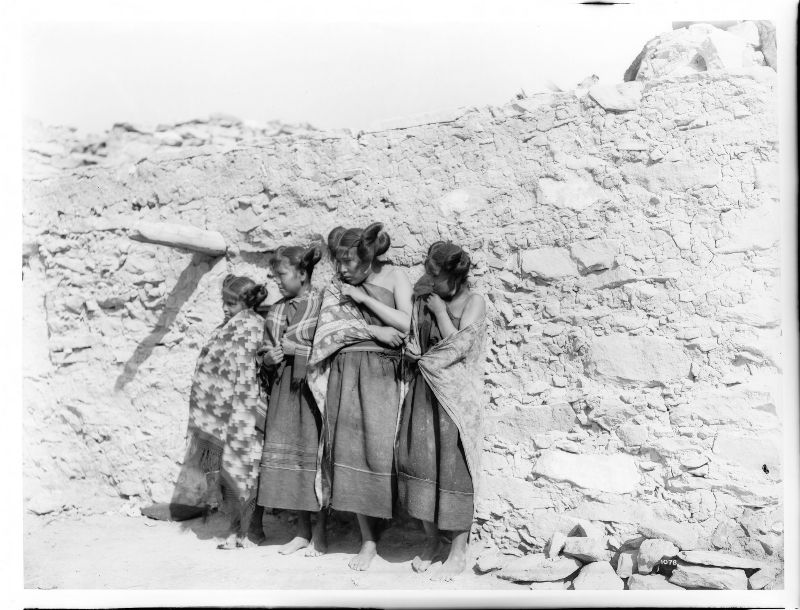 Hopi Indian girls standing in a row in the village of Oraibi