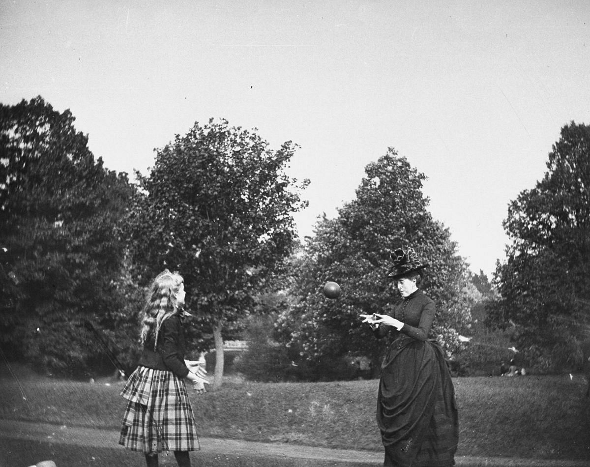 July 20, 1886 - Zelma Levison and her aunt Jo Grimwood throw a ball back and forth on a lawn in Prospect Park.