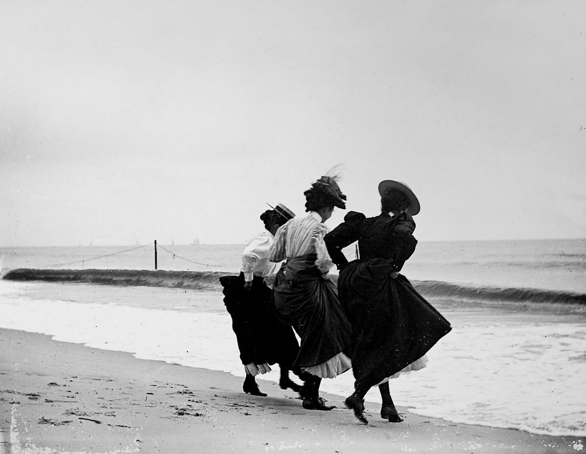 Sept. 8, 1897 - Gertrude Hubbell, Ruth Peters, and Mildred Grimwood play near the water at Arverne, Queens.