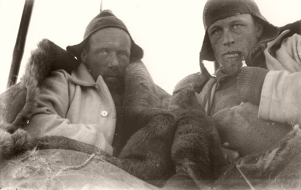 Wild and Watson in sleeping bag tent on sledge journey, circa 1912