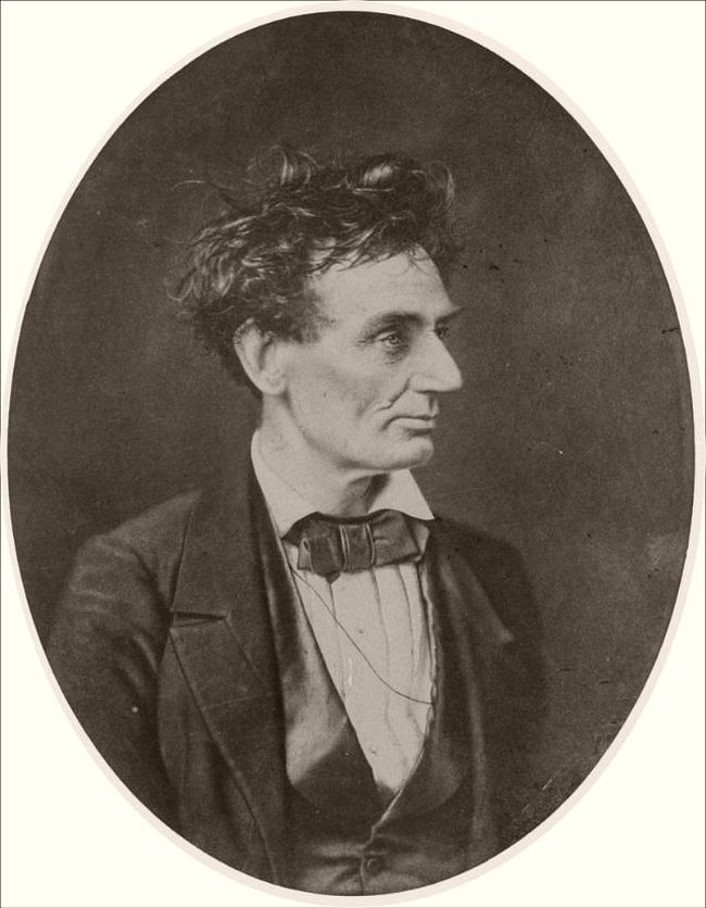 """February 28, 1857 – Alexander Hessler """"I have a letter from Mr. Hesler stating that [Lincoln] came in and made arrangements for the sitting, so that the members of the bar could get prints. Lincoln said at the time that he did not know why the boys wanted such a homely face. Joseph Medill went with Mr. Lincoln to have the picture taken. He says that the photographer insisted on smoothing down Lincoln's hair, but Lincoln did not like the result, and ran his fingers through it before sitting."""" —H. W. Fay of DeKalb, Illinois, original owner of the photo. Lincoln immediately prior to his Senate nomination. The original negative was burned in the Great Chicago Fire."""
