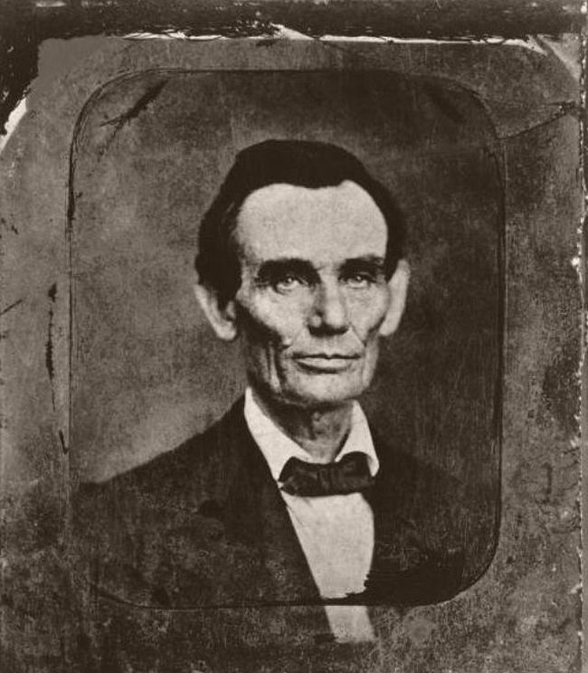 """May 27, 1857 – Amon T. Joslin Although some historians have dated this photograph during the court session of November 13, 1859, and others have placed it as early as 1853, most authorities now believe it was taken on May 27, 1857. The photographer Amon T. Joslin owned """"Joslin's Gallery"""" located on the second floor of a building adjoining the Woodbury Drug Store, in Danville, IL. This was one of Lincoln's favorite stopping places in Vermilion County, Illinois, while he was a traveling lawyer. Joslin photographed Abraham Lincoln twice at this sitting. Lincoln kept one copy and gave the other to his friend, Thomas J. Hilyard, deputy sheriff of Vermilion County. Today, one original resides in the Illinois State Historical Library."""