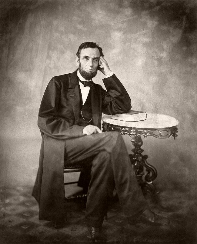 """August 9, 1863 – Alexander Gardner Lincoln's """"Photographer's Face"""". Per Dr. James Miner, """"His large bony face when in repose was unspeakably sad and as unreadable as that of a sphinx, his eyes were as expressionless as those of a dead fish; but when he smiled or laughed at one of his own stories or that of another then everything about him changed; his figure became alert, a lightning change came over his countenance, his eyes scintillated and I thought he had the most expressive features I had ever seen on the face of a man."""""""