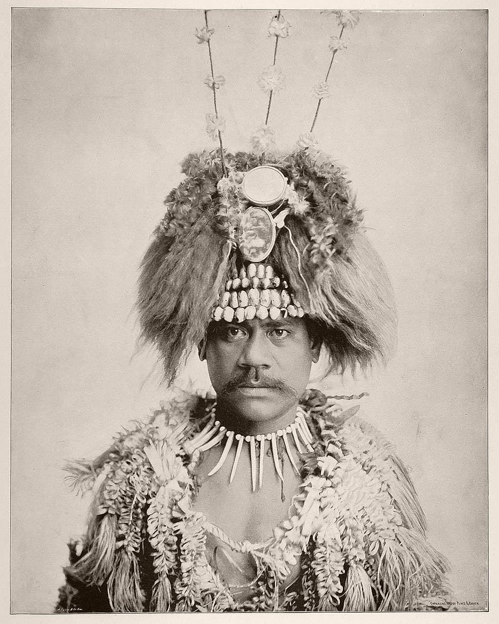 William, a Samoan man, in his traditional costume and elaborate headdress.