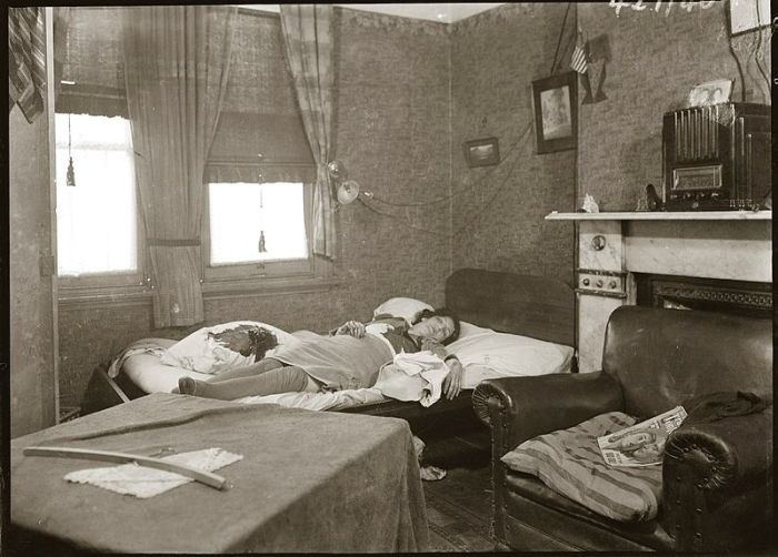 Bedroom with female murder victim on bed. Location and details unknown; presumably Sydney, ca 1942.