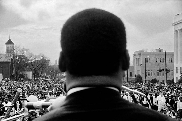 Stephen Somerstein Dr. Martin Luther King, Jr. speaking to 25,000 civil rights marchers at end of Selma to Montgomery, Alabama march, March 25, 1965