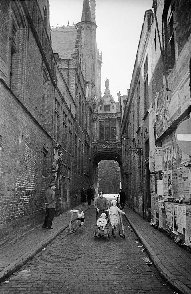 People in Blinde-Ezelstraat (Rue Juvée) street, Bruges, Belgium, 1934