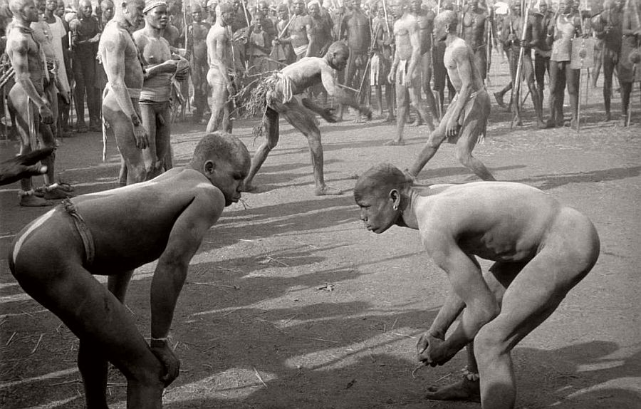 SUDAN. A gathering of the Nuba tribe in the Korongo Jebels (mountians). The Nubas pride themselves as wrestlers, their tribal sport. They are powdered in wood ash so they can get a grip of each other. 1949.