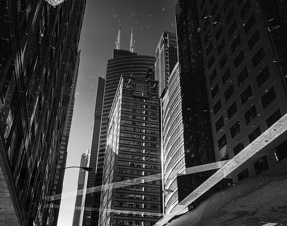 Puddle reflections, downtown Chicago