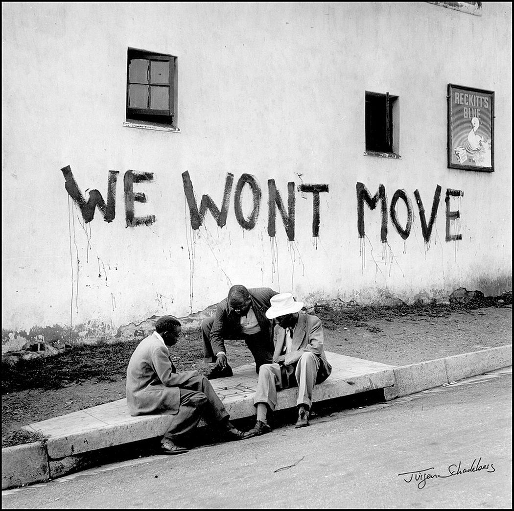 "In Sophiatown the people said ""We Won't Move!.""...and when the police arrived that first day people banged and tapped with stones and iron bars against the lamposts, and Sophiatown echoed in defiance.... 1955"