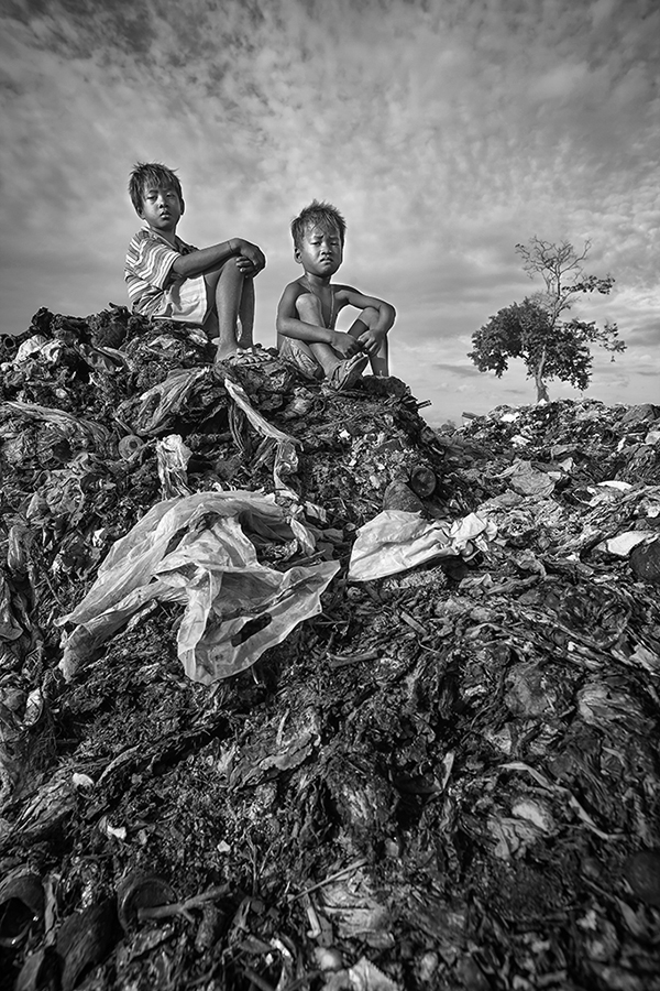 Close to their small countryside village, two children went to play together to what remains of a natural forest and now serves the village as a dumping ground which has been used as such for more than ten years. The place is considered by the children as their playground.