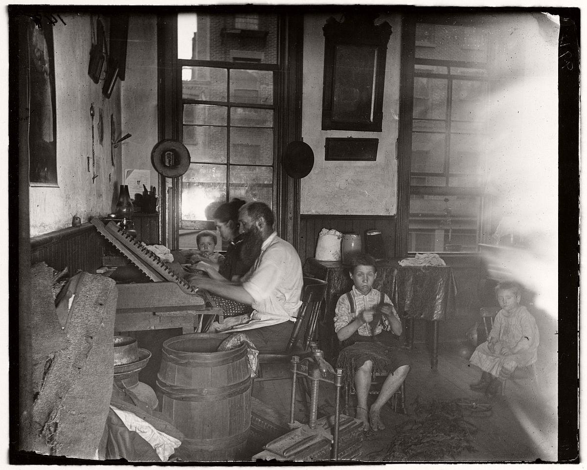 Bohemian cigar makers at work in their tenement.