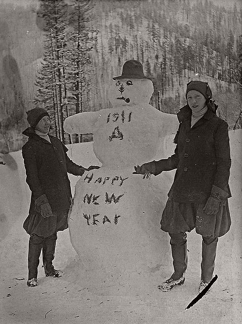 Two children with a snowman greeting the New Year 1911