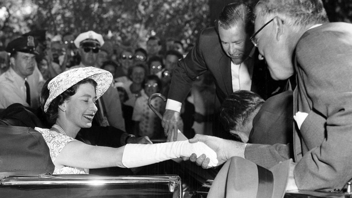 Chicago Tribune historical photo Queen Elizabeth II greets Chancellor Lawrence Kimpton of the University of Chicago during the British monarch's visit to Chicago on July 6, 1959.