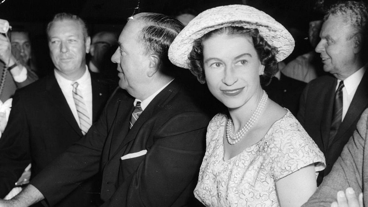 Chicago Tribune historical photo Queen Elizabeth II, in Chicago for a whirlwind visit July 6, 1959, sits with Mayor Richard J. Daley in a special cart while touring the International Trade Fair at Navy Pier.
