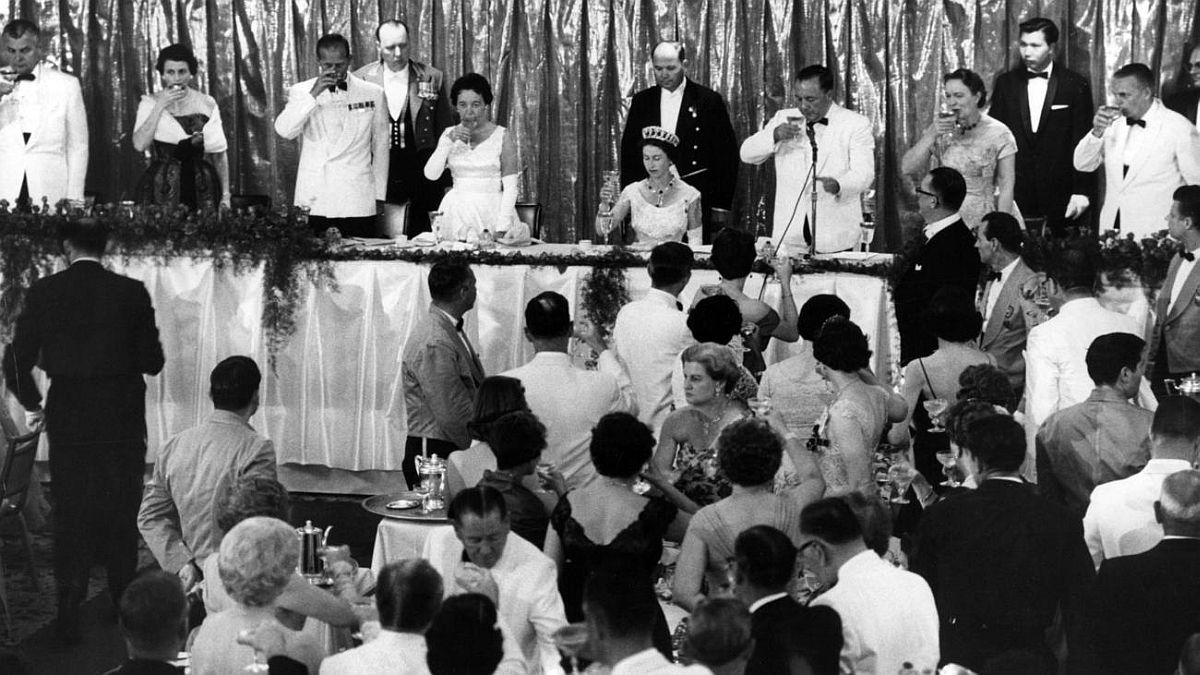 Chicago Tribune historical photo Guests toast Queen Elizabeth II during a dinner at the grand ballroom in Chicago's Hilton Hotel on July 6, 1959. The queen also offered a toast extending greetings to President Dwight Eisenhower.