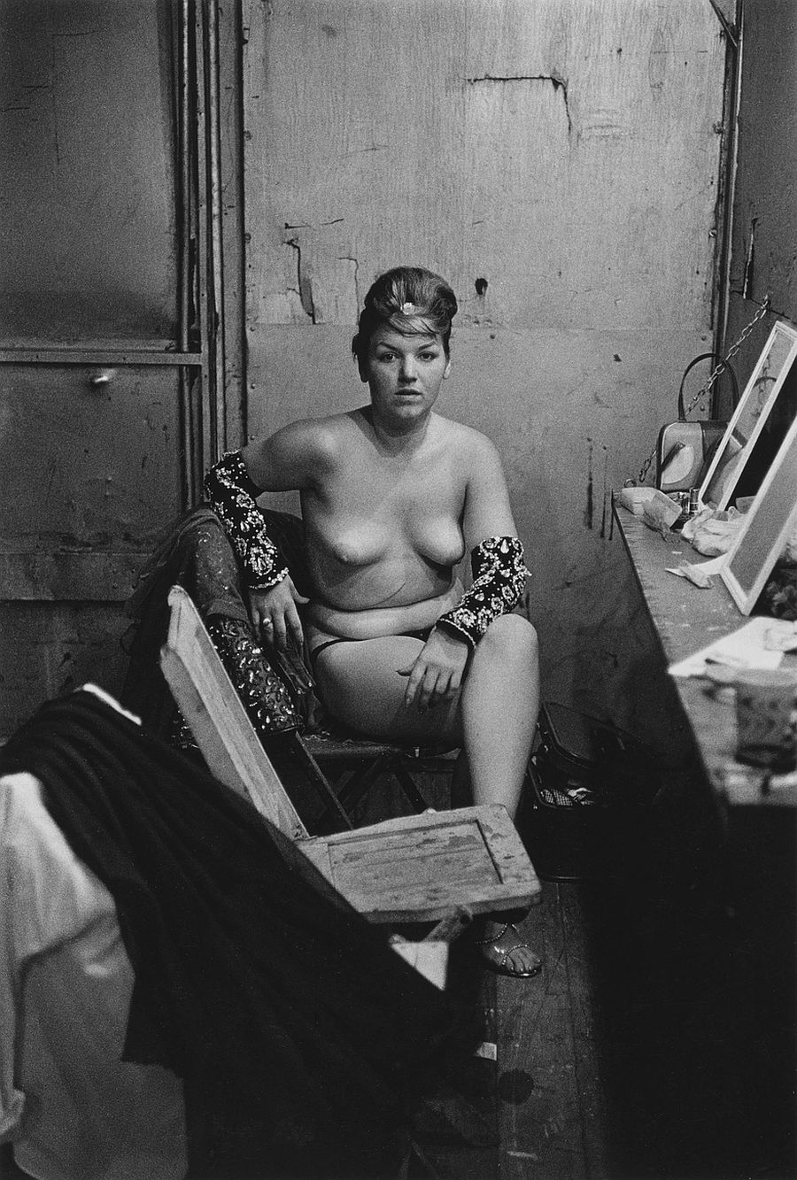 Diane Arbus, Stripper with bare breasts sitting in her dressing room, Atlantic City, N.J. , 1961