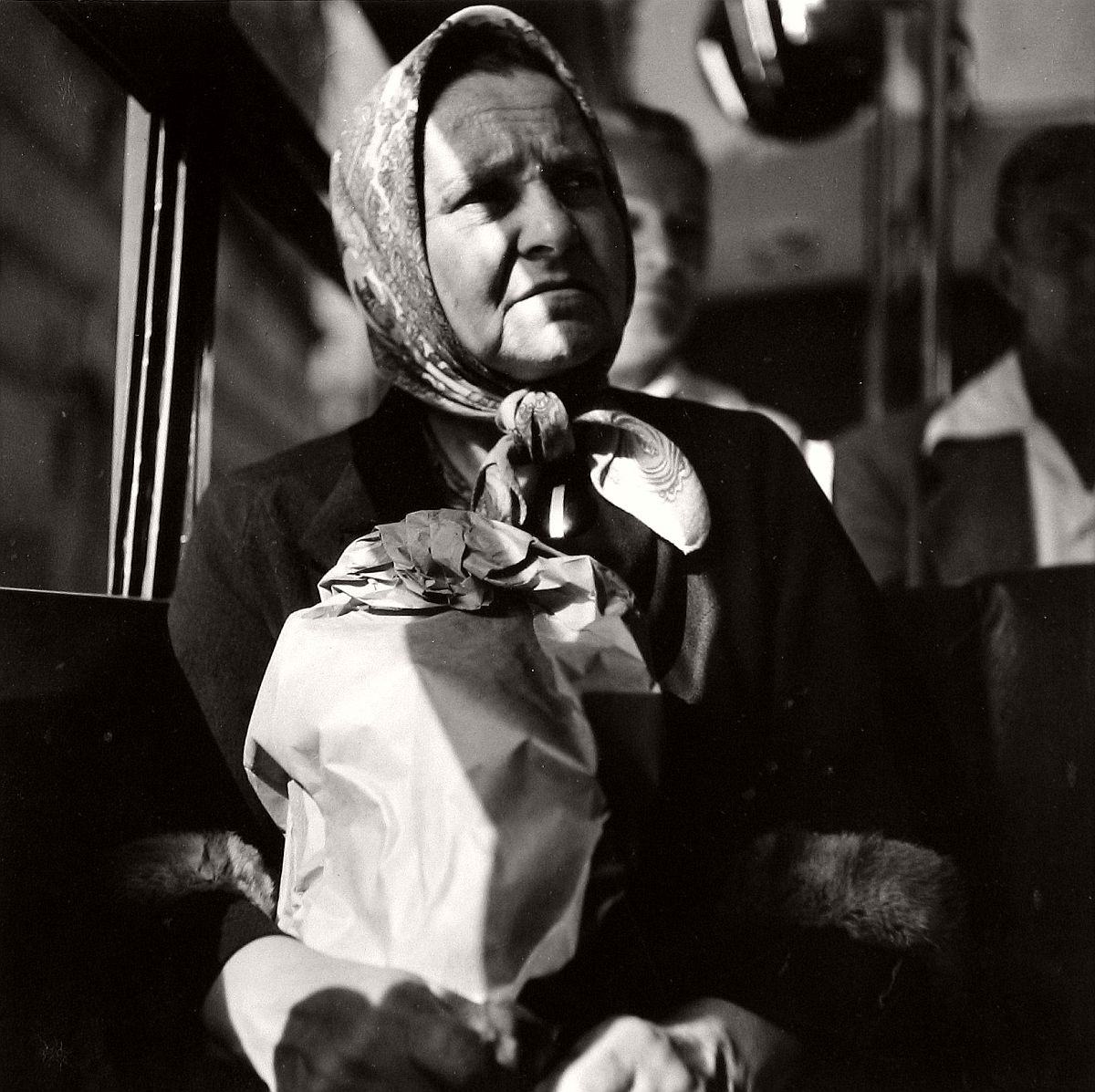 Woman on bus with shopping bag, 1949