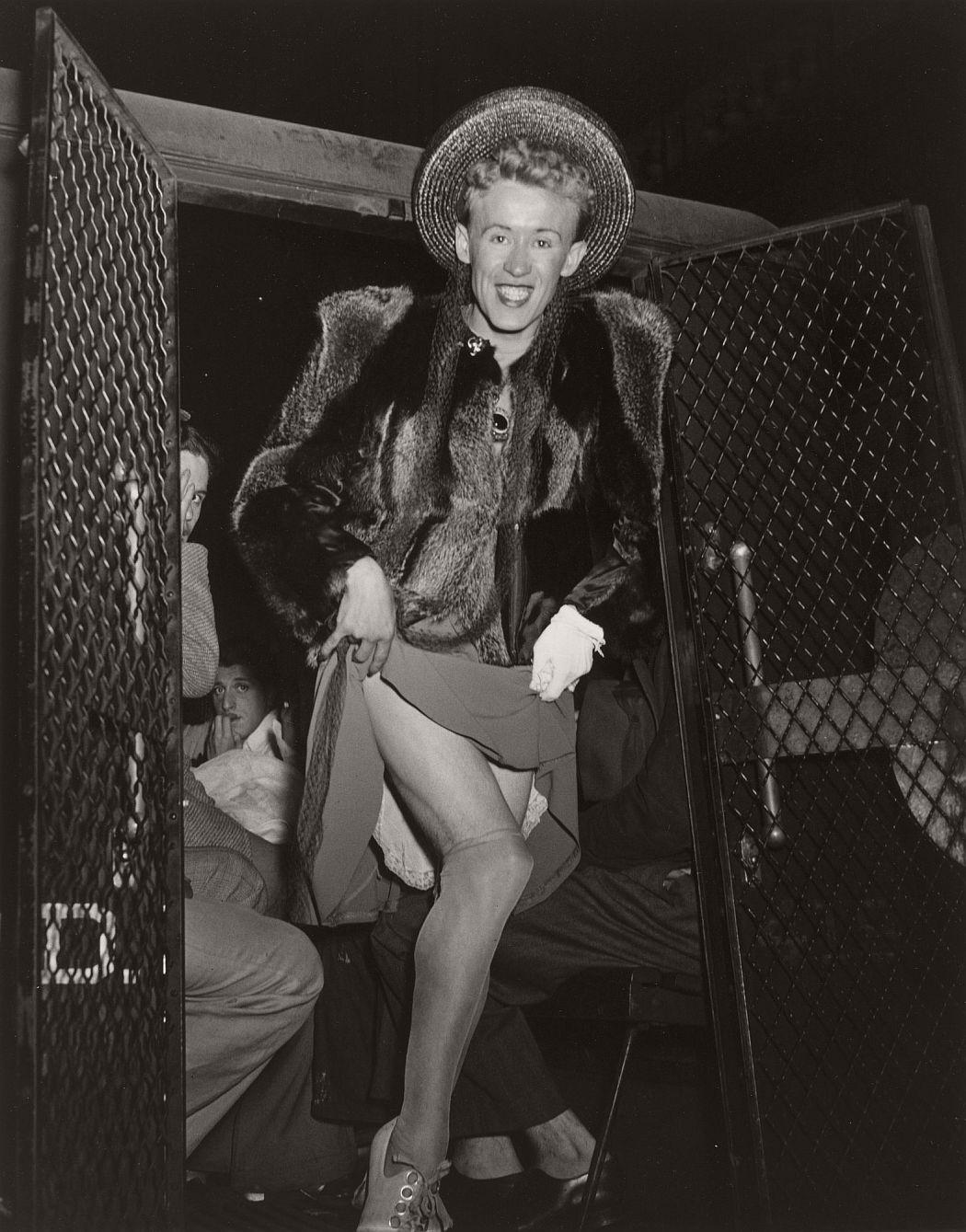 Weegee (American, born Austria. 1899–1968). The Gay Deceiver. c. 1939. Gelatin silver print, 13 × 10 1/4″ (33 × 26 cm). The Museum of Modern Art, New York. Promised gift of Robert B. Menschel. © Weegee/International Center of Photography