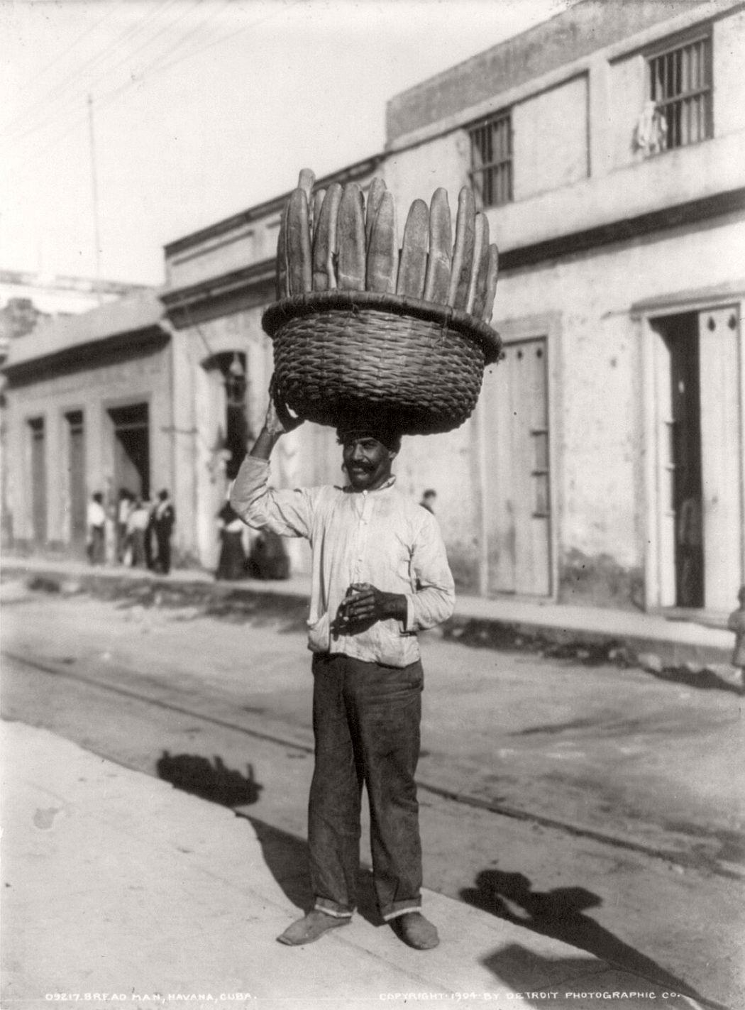 A bread man on a street in Havana, 1904