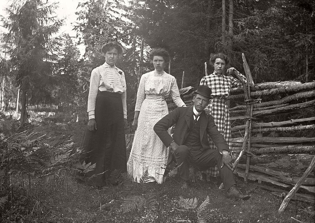 Three ladies and a gentleman.