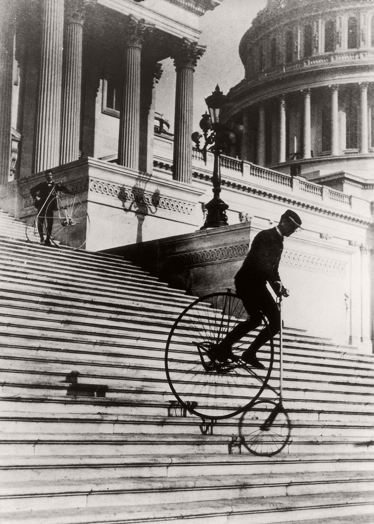 Men ride penny-farthings down the steps of the United States capitol building, 1895. (Getty Images)