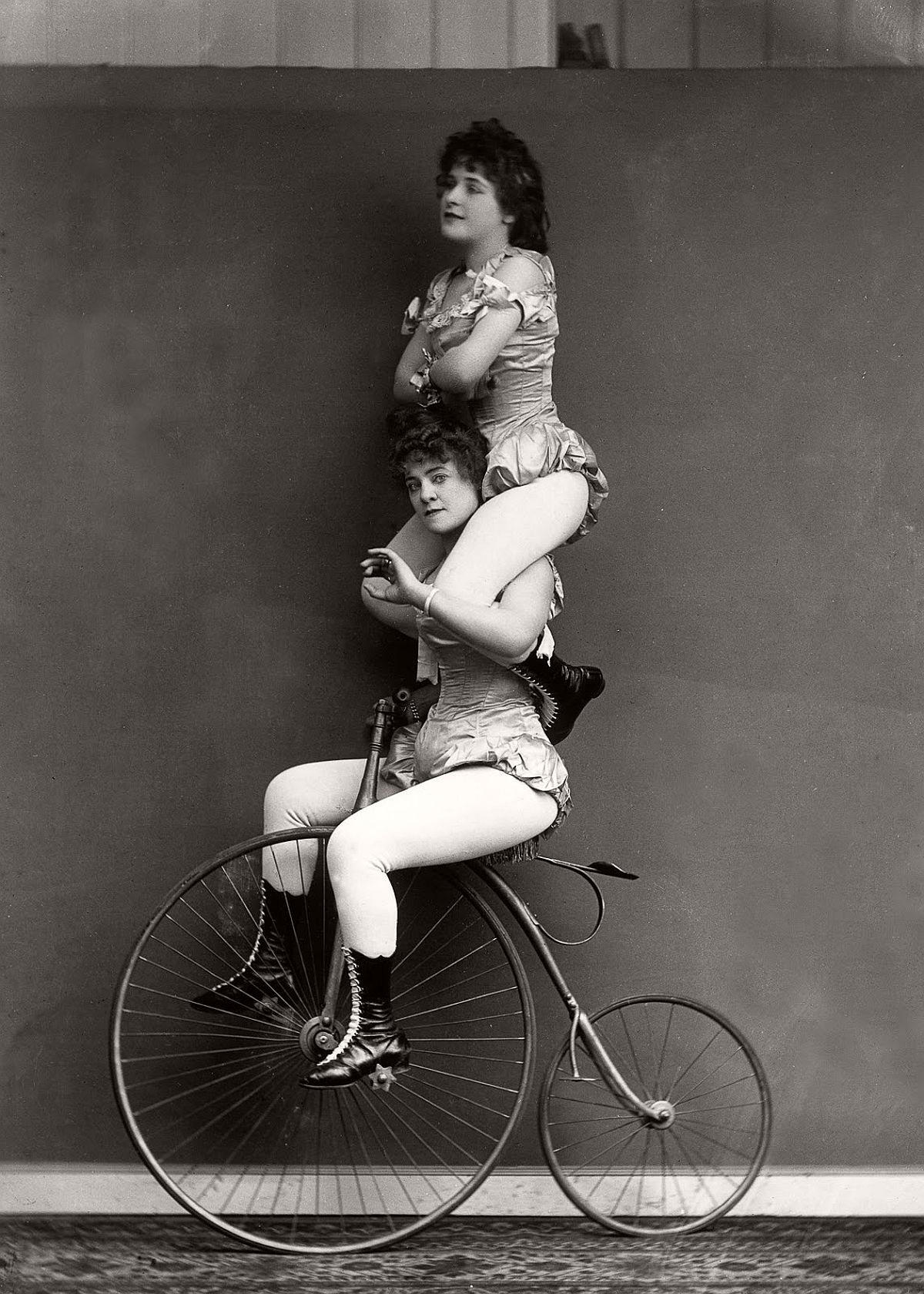 Victorian cyclists perform a balancing act on a penny-farthing, 1891. (Getty Images)