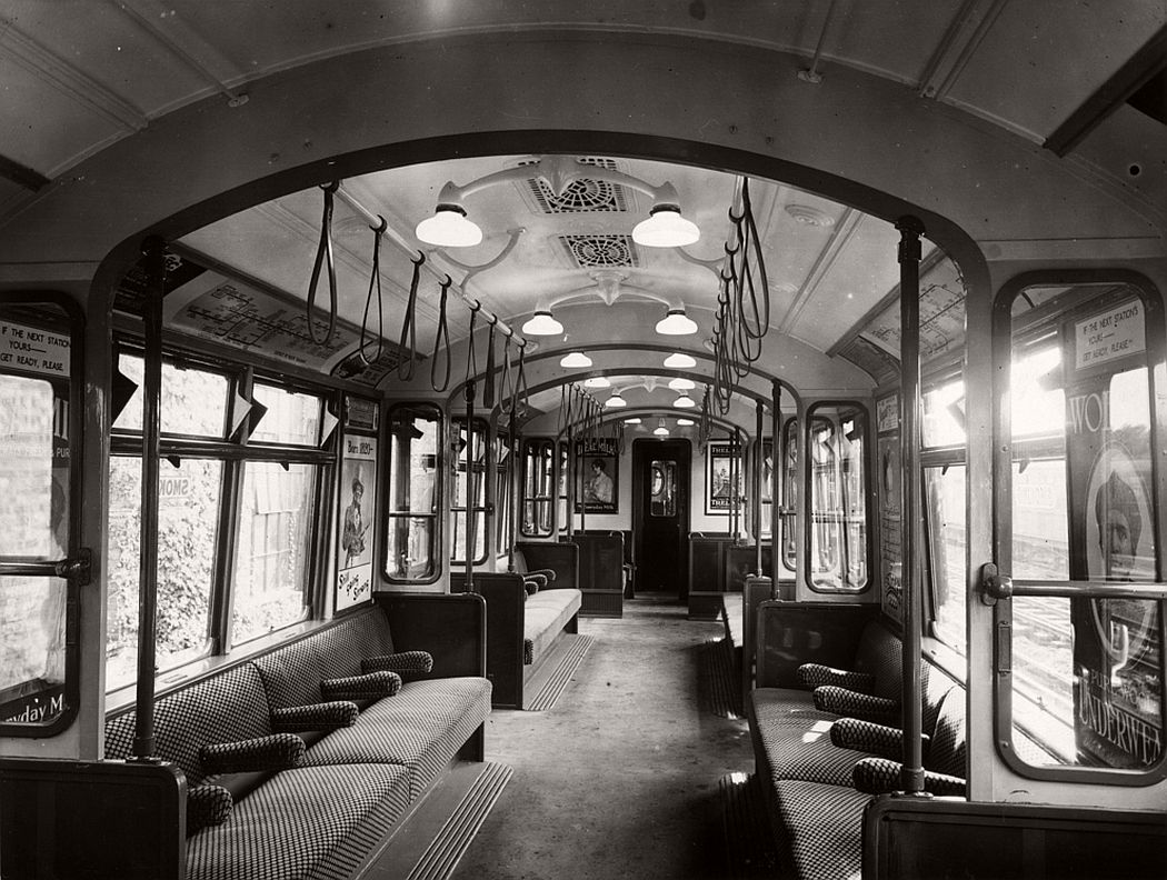 Interior of an all-steel London underground train, ca. 1920.