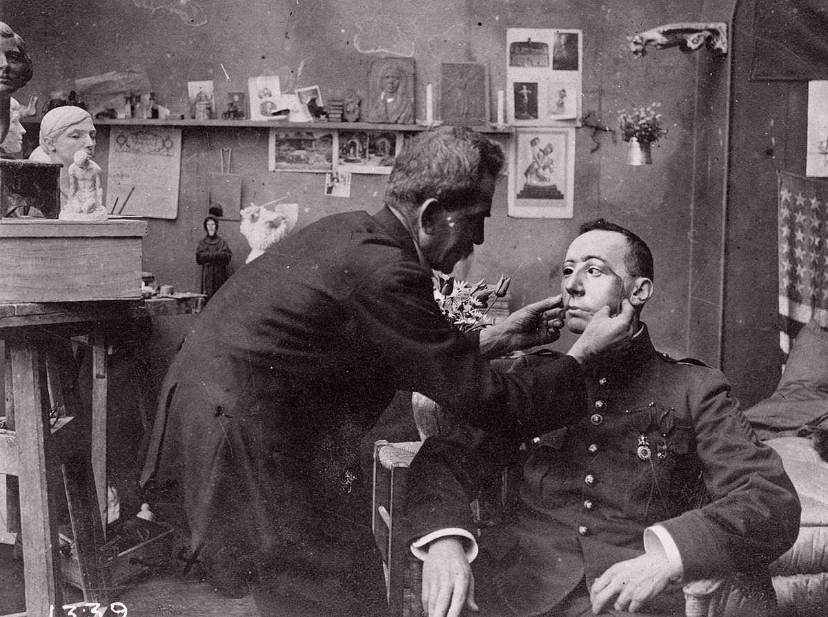 French soldier whose face was mutilated in World War I, being fitted with a mask made at the American Red Cross studio of Anna Coleman Ladd. # Library of Congress