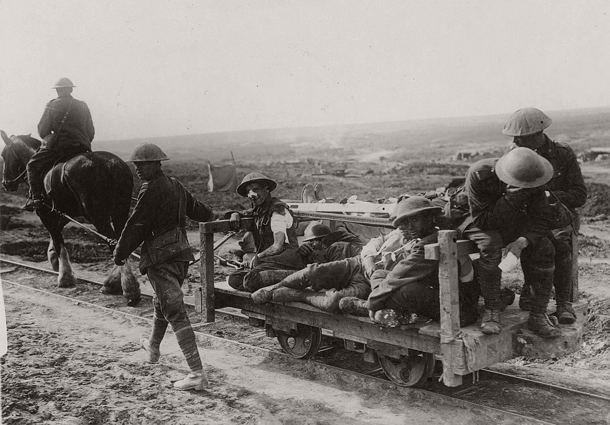 Some Canadian wounded being taken to the dressing station on a light railway from the firing line. # Nationaal Archief