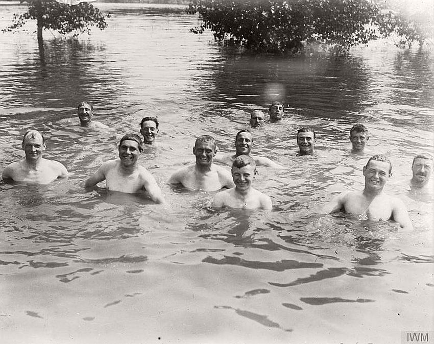 Soldiers smile for the camera during a swim in the Somme region, France, 1916.