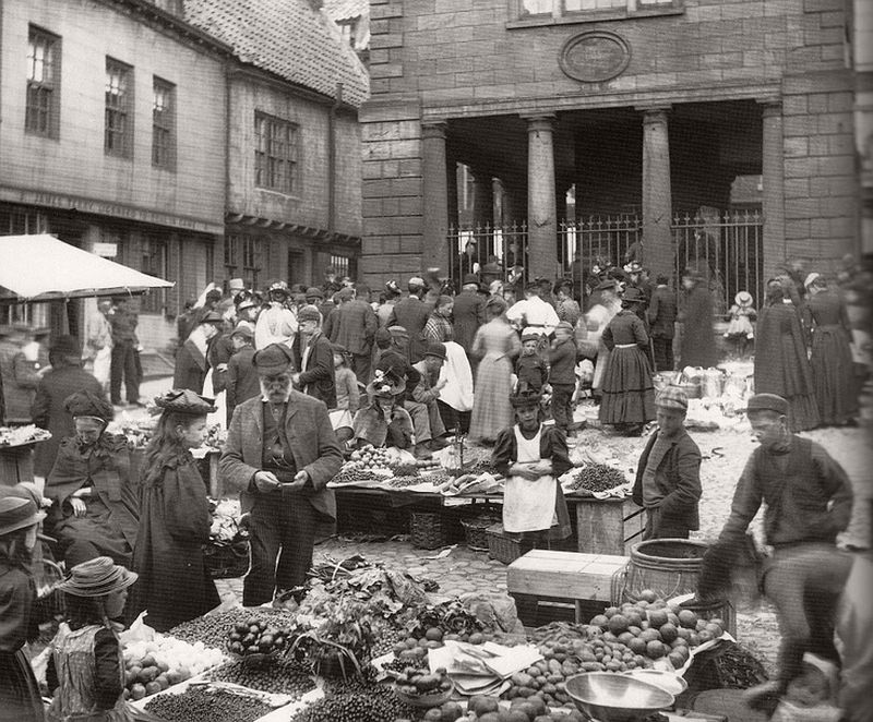 Market place in Whitby with the Town Hall in the background, ca. 1900