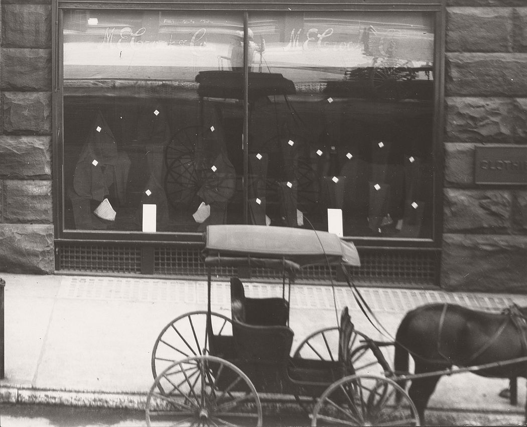 Store front window of M.E. Croak and Company Clothier on the southeast corner of Olive and Tenth Streets, 1904