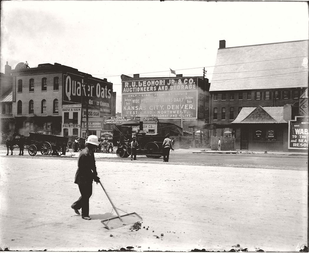 Street cleaner at work on Twelfth Street between Olive and Locust Streets, 1909
