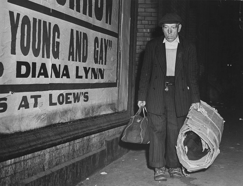 A bowery bum with all his possessions moving about town, c.1940s