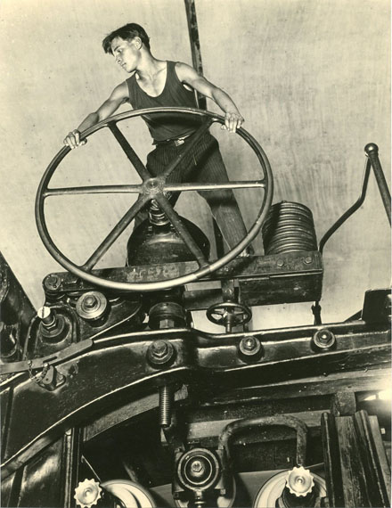Arkadiy Shaihet. Komsomol member holding a wheel of paper-making machine. Balakhna. 1929