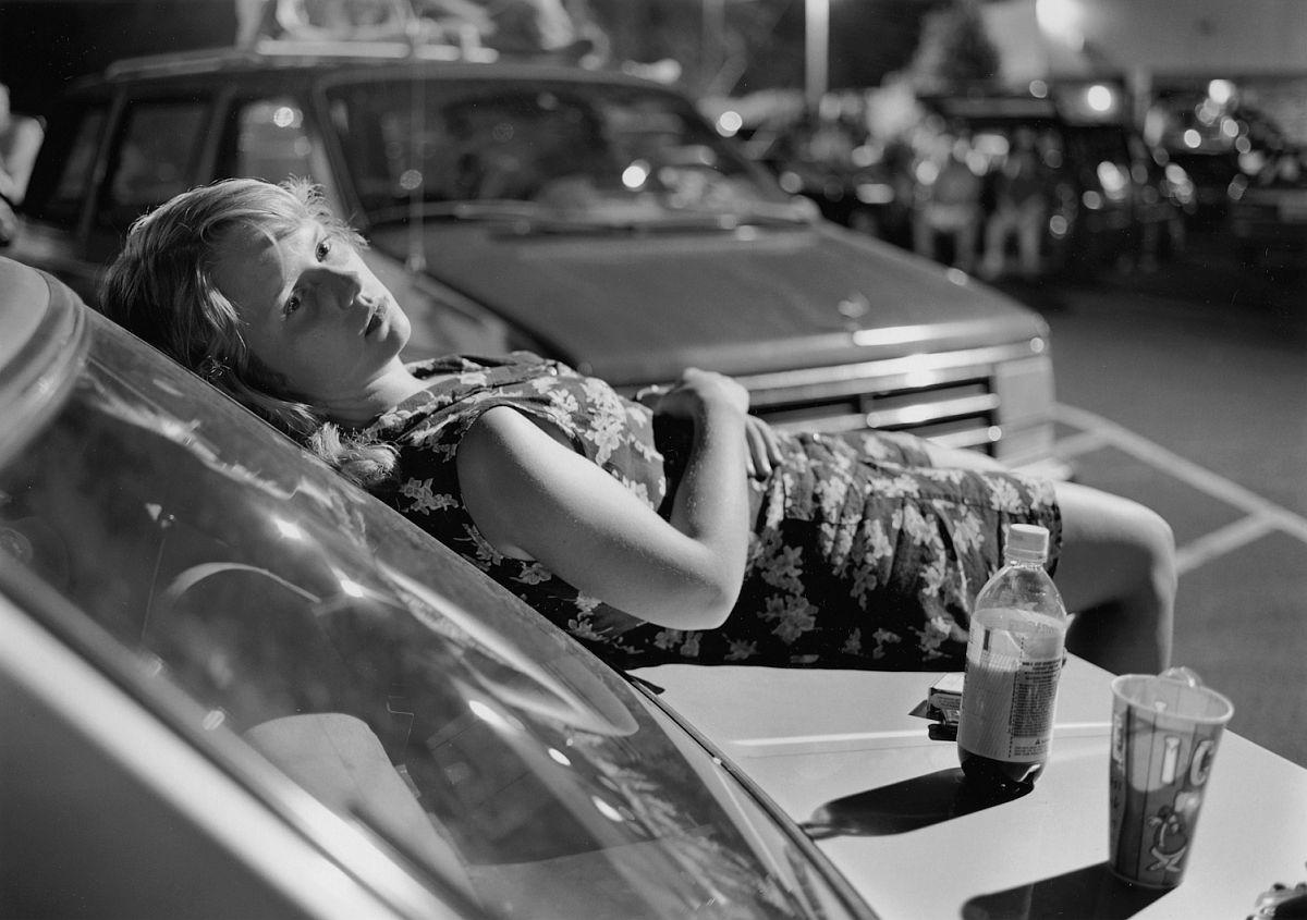Mark Steinmetz, Athens, GA (girl on hood of car), 1996.