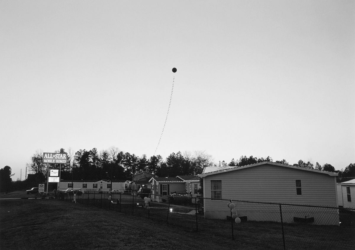 Mark Steinmetz, Athens, GA (balloon at dusk), 1995.
