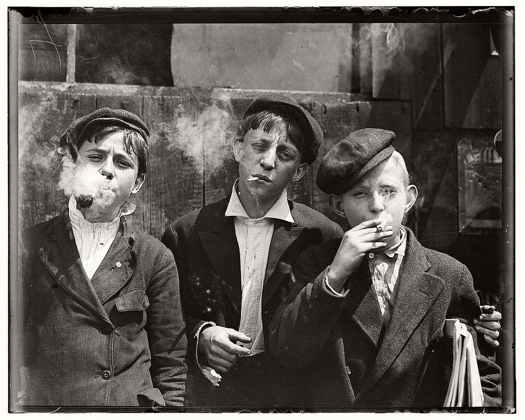 Newsies smoking at Skeeter's Branch, St. Louis, Missouri, May 9, 1910