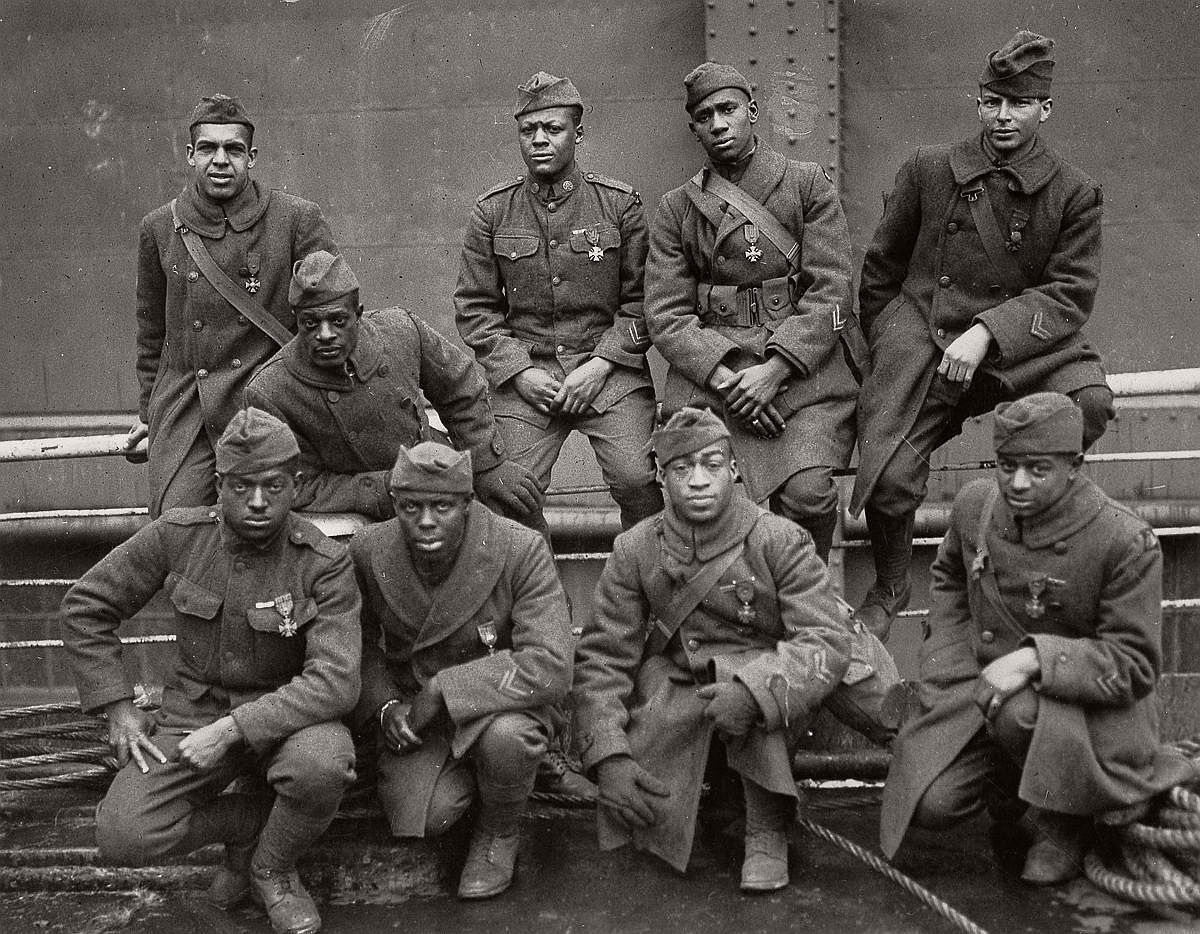 Soldiers of the 369th wearing the Cross of War medal pose for a photo on their trip back to New York, 1919. (National Archives)