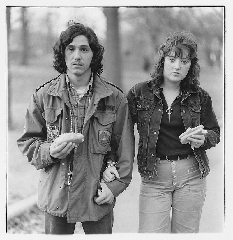 A young man and his girlfriend with hot dogs in the park, N.Y.C. 1971 © The Estate of Diane Arbus