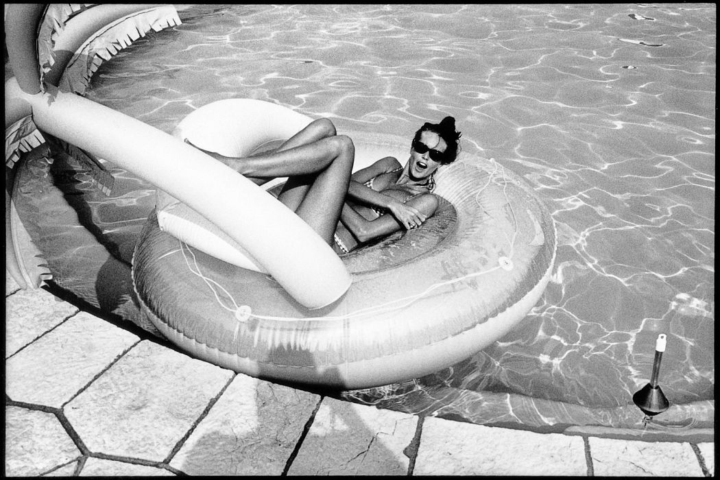 Elle Macpherson lounging in an inflatable in 1991.