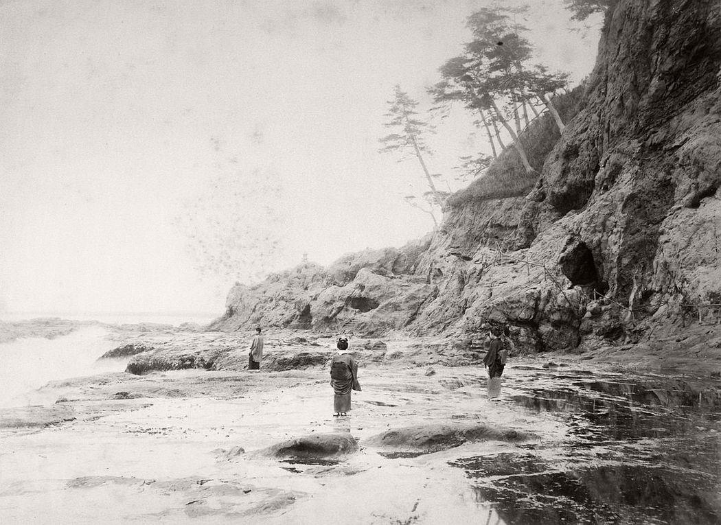 Young man and two women at Enoshima Caves, ca. 1880