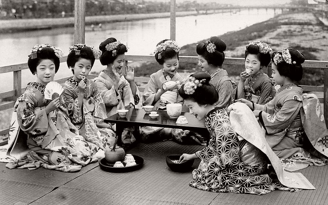 A group of Maiko girls on a balcony overlooking the Kamo River in Kyoto, ca. late 1910s