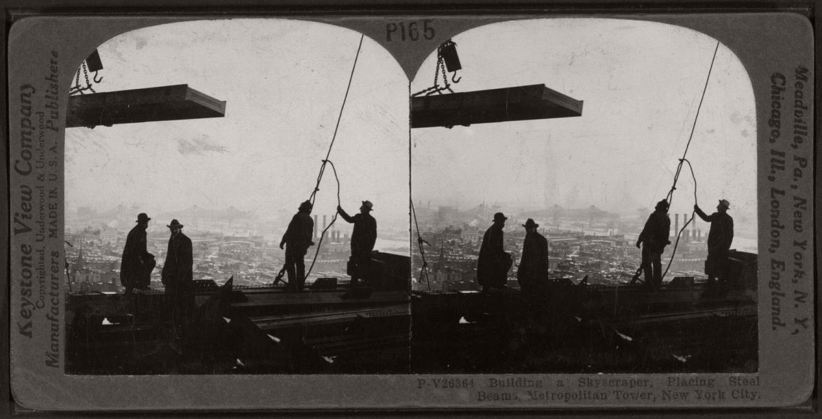 Workers place steel beams for the Metropolitan Tower. Photograph: The Research Libraries, New York/Keystone View Company/Underwood & Underwood