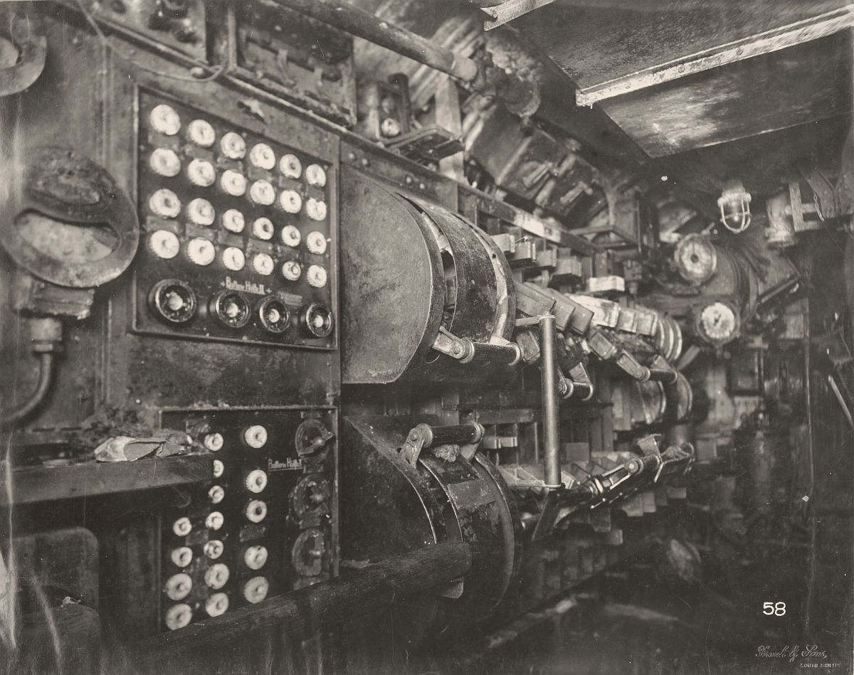 This photograph shows the U-Boat 110, a German Submarine that was sunk and risen in 1918. This photograph shows the Submarine's Electric Control Room, including its switch gear.