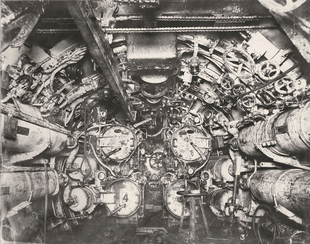 This photograph shows the U-Boat 110, a German Submarine that was sunk and risen in 1918. This photograph shows the Submarine's forward Torpedo room.