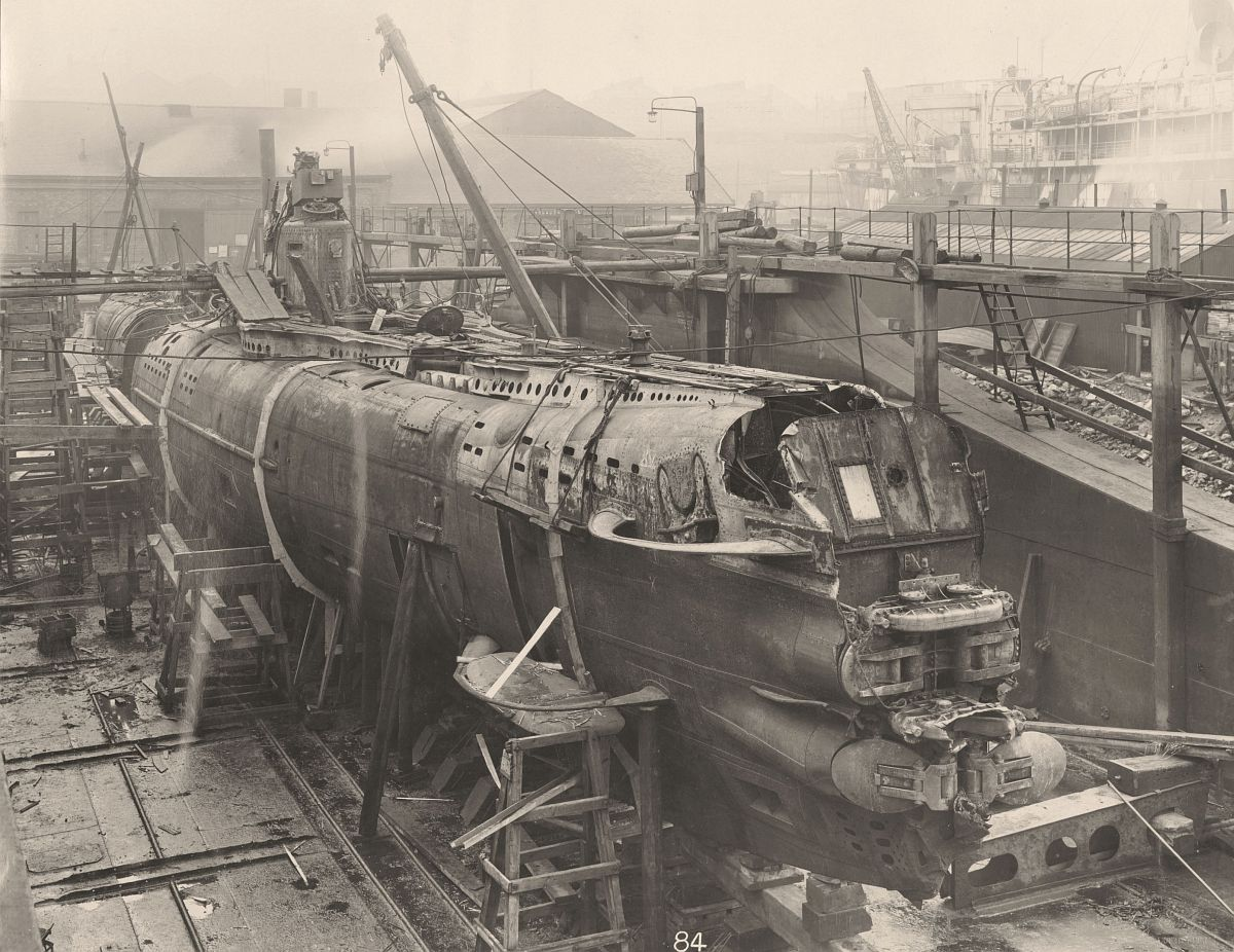 This photograph shows the U-Boat 110, a German Submarine that was sunk and risen in 1918. This photograph shows the a general view of the Submarine.