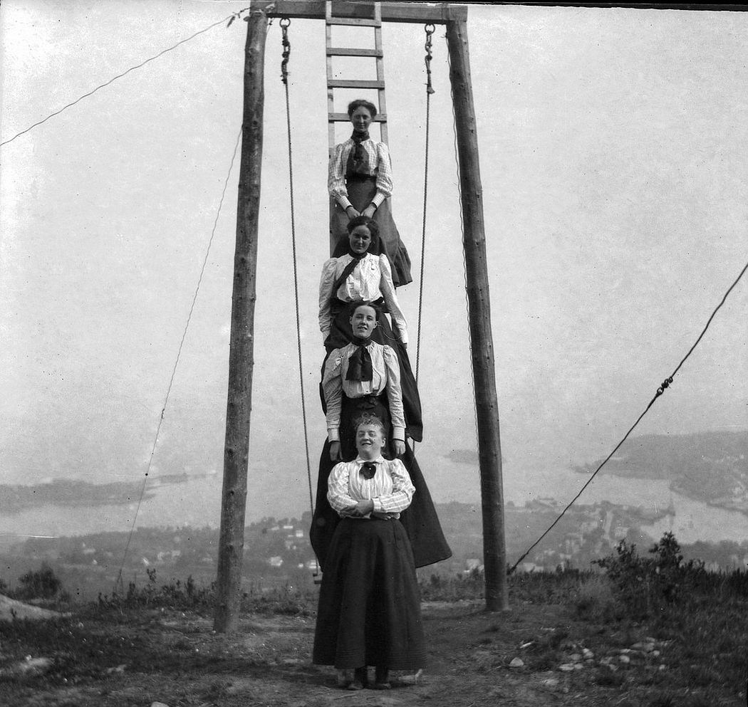 Friends and family of Theresa Babb perched on a ladder by the Summit House swing on August 17, 1898. Her sister Grace Parker is at the top of the ladder. The Summit House hotel was built in 1897 by Columbus Buswell. The property was purchased in 1899 by the Mt. Battie Association and renovated the same year.
